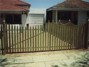 Raw Windsor Pine Timber Scolloped Driveway Gates To Match Fence, With Steel Framework Kensington.