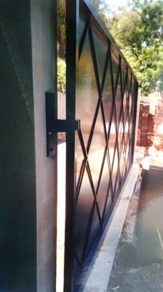 Black Nightsky Sliding Colorbond Gate Rear Face With Latticework Design To Suit Timber Lattice Inside Property.
